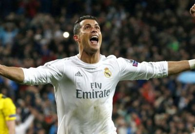 epa05256103 Real Madrid's Portuguese striker Cristiano Ronaldo celebrates his third goal against Wolfsburg during the UEFA Champions League quarter final second leg match played at Santiago Bernabeu stadium in Madrid, Spain on 12 April 2016.  EPA/JJ GUILLEN